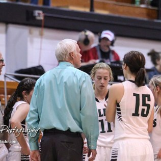 Central Plains Lady Oiler Head Coach Pat Stiles addresses his players during a time out. The Central Plains Lady Oilers defeated Hoisington Lady Cardinals by a score of 88 to 23 in a basketball game held at Central Plains High School in Claflin, Kansas on December 1, 2017. (Photo: Joey Bahr, www.joeybahr.com)