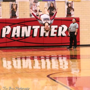 Buhler Crusader Cheerleader Carsyn Heinlein spins through the air as part of a cheer during a full time out. The Buhler Crusaders defeated the Great Bend Panthers by a score of 44 to 36 the Great Bend High School Field House in Great Bend, Kansas on January 12, 2018. (Photo: Joey Bahr, www.joeybahr.com)