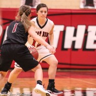 Great Bend Lady Panther #12 Sydney Unruh drives with the ball as Buhler Lady Crusader #1 Haley Miller defends. The Great Bend Lady Panthers defeated the Buhler Lady Crusaders by a score of 52 to 38 the Great Bend High School Field House in Great Bend, Kansas on January 12, 2018. (Photo: Joey Bahr, www.joeybahr.com)