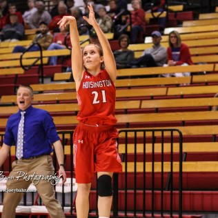 Hoisington Lady Cardinal #21 Suzanna Schneider shoots a three point shot. The Hoisington Lady Cardinals defeated the Ellinwood Lady Eagles by a score of 46 to 19 in the Consolation Semi-Final of the 2018 Hoisington Winter Jam at the Hoisington Activity Center in Hoisington, Kansas on January 18, 2018. (Photo: Joey Bahr, www.joeybahr.com)
