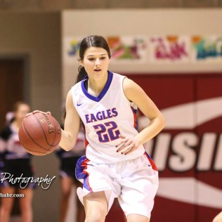 Ellinwood Lady Eagle #22 Kennedy Harrington bring the ball down the court. The Hoisington Lady Cardinals defeated the Ellinwood Lady Eagles by a score of 46 to 19 in the Consolation Semi-Final of the 2018 Hoisington Winter Jam at the Hoisington Activity Center in Hoisington, Kansas on January 18, 2018. (Photo: Joey Bahr, www.joeybahr.com)
