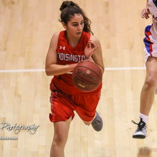 Hoisington Lady Cardinal #22 Iris Suarez brings the ball down the court. The Hoisington Lady Cardinals defeated the Ellinwood Lady Eagles by a score of 46 to 19 in the Consolation Semi-Final of the 2018 Hoisington Winter Jam at the Hoisington Activity Center in Hoisington, Kansas on January 18, 2018. (Photo: Joey Bahr, www.joeybahr.com)