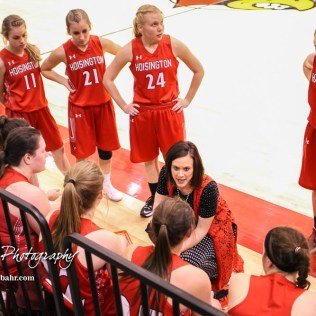 Hoisington Lady Cardinal Head Coach Mandy Mason addresses her players during a timeout between the third and fourth quarter. The Hoisington Lady Cardinals defeated the Ellinwood Lady Eagles by a score of 46 to 19 in the Consolation Semi-Final of the 2018 Hoisington Winter Jam at the Hoisington Activity Center in Hoisington, Kansas on January 18, 2018. (Photo: Joey Bahr, www.joeybahr.com)