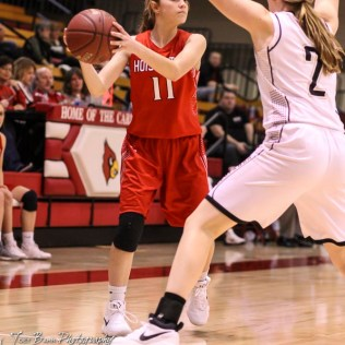 Hoisington Lady Cardinal #11 Keeley Wolf looks for an open teammate. The LaCrosse Lady Leopards defeated the Hoisington Lady Cardinals by a score of 32 to 27 in the First Round of the 2018 Hoisington Winter Jam at the Hoisington Activity Center in Hoisington, Kansas on January 16, 2018. (Photo: Joey Bahr, www.joeybahr.com)