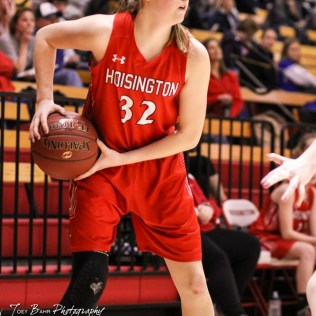 Hoisington Lady Cardinal #32 Kelsi Dalton looks for an open teammate to pass the ball to. The LaCrosse Lady Leopards defeated the Hoisington Lady Cardinals by a score of 32 to 27 in the First Round of the 2018 Hoisington Winter Jam at the Hoisington Activity Center in Hoisington, Kansas on January 16, 2018. (Photo: Joey Bahr, www.joeybahr.com)
