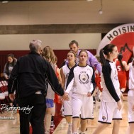 Members of the Hoisington Lady Cardinals and LaCrosse Lady Leopards shake hands following the game. The LaCrosse Lady Leopards defeated the Hoisington Lady Cardinals by a score of 32 to 27 in the First Round of the 2018 Hoisington Winter Jam at the Hoisington Activity Center in Hoisington, Kansas on January 16, 2018. (Photo: Joey Bahr, www.joeybahr.com)