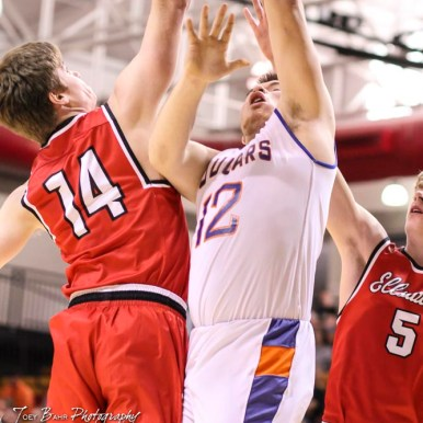 Otis-Bison Cougar #12 Luke Higgason goes for a layup as Ellsworth Bearcat #14 Grant Gwinner tries to block. The Ellsworth Bearcats defeated the Otis-Bison Cougars by a score of 58 to 37 in the Third Place game of the 2018 Hoisington Winter Jam at the Hoisington Activity Center in Hoisington, Kansas on January 20, 2018. (Photo: Joey Bahr, www.joeybahr.com)