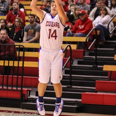 Otis-Bison Cougar #14 Seth Hoopingarner shoots a deep jump shot. The Ellsworth Bearcats defeated the Otis-Bison Cougars by a score of 58 to 37 in the Third Place game of the 2018 Hoisington Winter Jam at the Hoisington Activity Center in Hoisington, Kansas on January 20, 2018. (Photo: Joey Bahr, www.joeybahr.com)