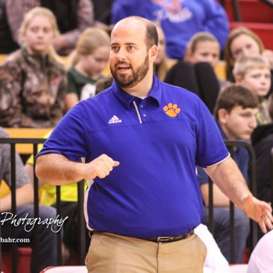Otis-Bison Cougar Head Coach Curtis Little discusses a move with an official. The Ellsworth Bearcats defeated the Otis-Bison Cougars by a score of 58 to 37 in the Third Place game of the 2018 Hoisington Winter Jam at the Hoisington Activity Center in Hoisington, Kansas on January 20, 2018. (Photo: Joey Bahr, www.joeybahr.com)