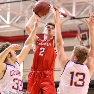 Ellsworth Bearcat #2 Remington Cravens shoots a jump shot over Otis-Bison Cougars #33 Anton Foust and #13 Clade Anderson. The Ellsworth Bearcats defeated the Otis-Bison Cougars by a score of 58 to 37 in the Third Place game of the 2018 Hoisington Winter Jam at the Hoisington Activity Center in Hoisington, Kansas on January 20, 2018. (Photo: Joey Bahr, www.joeybahr.com)