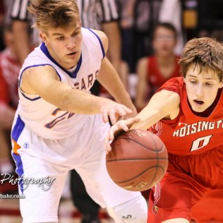 Otis-Bison Cougar #23 Maitland Wiltse tries to poke away the ball from Hoisington Cardinal #0 Drew Nicholson. The Hoisington Cardinals defeated the Otis-Bison Cougars by a score of 58 to 46 in the Semi-Final of the 2018 Hoisington Winter Jam at the Hoisington Activity Center in Hoisington, Kansas on January 19, 2018. (Photo: Joey Bahr, www.joeybahr.com)