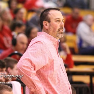 Hoisington Cardinal Head Coach Kyle Haxton watches a play develop. The Hoisington Cardinals defeated the Otis-Bison Cougars by a score of 58 to 46 in the Semi-Final of the 2018 Hoisington Winter Jam at the Hoisington Activity Center in Hoisington, Kansas on January 19, 2018. (Photo: Joey Bahr, www.joeybahr.com)