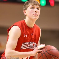 Hoisington Cardinal #21 Isaac Prosser shoots a free throw attempt. The Hoisington Cardinals defeated the Otis-Bison Cougars by a score of 58 to 46 in the Semi-Final of the 2018 Hoisington Winter Jam at the Hoisington Activity Center in Hoisington, Kansas on January 19, 2018. (Photo: Joey Bahr, www.joeybahr.com)
