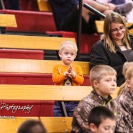 A young fan claps from the stands during warmups. The Otis-Bison Lady Cougars defeated the LaCrosse Lady Leopards by a score of 29 to 23 in the Semi-Final of the 2018 Hoisington Winter Jam at the Hoisington Activity Center in Hoisington, Kansas on January 19, 2018. (Photo: Joey Bahr, www.joeybahr.com)