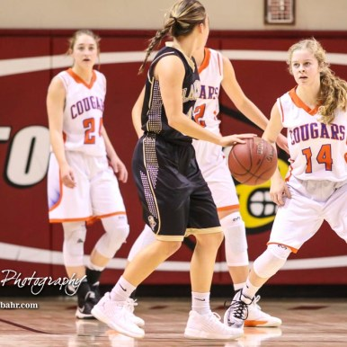 Otis-Bison Lady Cougar #14 Ashtyn Butler watches the ball while on defense. The Otis-Bison Lady Cougars defeated the LaCrosse Lady Leopards by a score of 29 to 23 in the Semi-Final of the 2018 Hoisington Winter Jam at the Hoisington Activity Center in Hoisington, Kansas on January 19, 2018. (Photo: Joey Bahr, www.joeybahr.com)