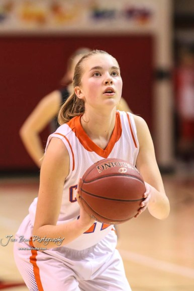 Otis-Bison Lady Cougar #22 Maddie Wiltse shoots a free throw attempt. The Otis-Bison Lady Cougars defeated the LaCrosse Lady Leopards by a score of 29 to 23 in the Semi-Final of the 2018 Hoisington Winter Jam at the Hoisington Activity Center in Hoisington, Kansas on January 19, 2018. (Photo: Joey Bahr, www.joeybahr.com)