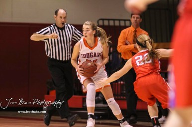 Otis-Bison Lady Cougar #22 Maddie Wiltse looks for a teammate to pass the ball to as Russell Lady Bronco #22 Samantha Leiker presses. The Russell Lady Broncos defeated the Otis-Bison Lady Cougars by a score of 54 to 34 in the Girls Championship game of the 2018 Hoisington Winter Jam at the Hoisington Activity Center in Hoisington, Kansas on January 20, 2018. (Photo: Joey Bahr, www.joeybahr.com)