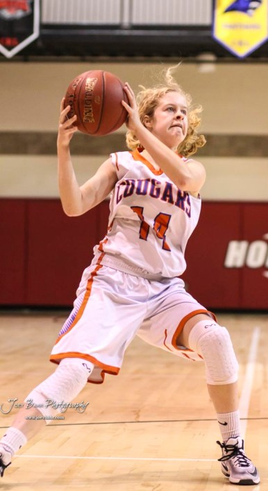 Otis-Bison Lady Cougar #14 Ashtyn Butler pulls in a ball passed to her. The Russell Lady Broncos defeated the Otis-Bison Lady Cougars by a score of 54 to 34 in the Girls Championship game of the 2018 Hoisington Winter Jam at the Hoisington Activity Center in Hoisington, Kansas on January 20, 2018. (Photo: Joey Bahr, www.joeybahr.com)