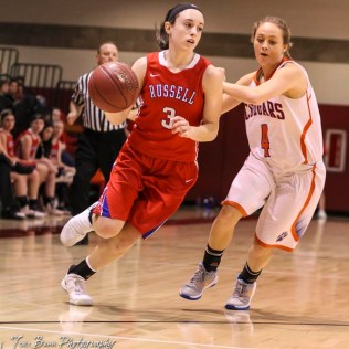 Russell Lady Bronco #3 Tiffany Dortland drives past Otis-Bison Lady Cougar #4 Sidney Schneider. The Russell Lady Broncos defeated the Otis-Bison Lady Cougars by a score of 54 to 34 in the Girls Championship game of the 2018 Hoisington Winter Jam at the Hoisington Activity Center in Hoisington, Kansas on January 20, 2018. (Photo: Joey Bahr, www.joeybahr.com)