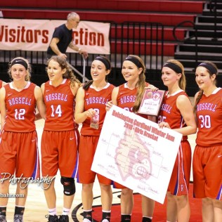 The Russell Lady Broncos pose with the championship trophy and bracket poster after the game. The Russell Lady Broncos defeated the Otis-Bison Lady Cougars by a score of 54 to 34 in the Girls Championship game of the 2018 Hoisington Winter Jam at the Hoisington Activity Center in Hoisington, Kansas on January 20, 2018. (Photo: Joey Bahr, www.joeybahr.com)