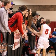 Hoisington Cardinal #0 Drew Nicholson greets fans during player introductions. The Hoisington Cardinals defeated the Pratt Greenbacks by a score of 47 to 41 in the Boys Championship game of the 2018 Hoisington Winter Jam at the Hoisington Activity Center in Hoisington, Kansas on January 20, 2018. (Photo: Joey Bahr, www.joeybahr.com)