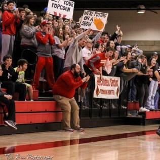 The Hoisington student section celebrates a made basket. The Hoisington Cardinals defeated the Pratt Greenbacks by a score of 47 to 41 in the Boys Championship game of the 2018 Hoisington Winter Jam at the Hoisington Activity Center in Hoisington, Kansas on January 20, 2018. (Photo: Joey Bahr, www.joeybahr.com)