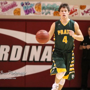 Pratt Greenback #4 Landen Studer brings the ball down the court. The Hoisington Cardinals defeated the Pratt Greenbacks by a score of 47 to 41 in the Boys Championship game of the 2018 Hoisington Winter Jam at the Hoisington Activity Center in Hoisington, Kansas on January 20, 2018. (Photo: Joey Bahr, www.joeybahr.com)