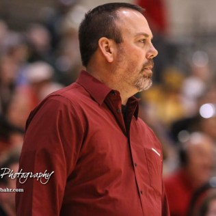 Hoisington Cardinal Head Coach Kyle Haxton watches a play develop. The Hoisington Cardinals defeated the Pratt Greenbacks by a score of 47 to 41 in the Boys Championship game of the 2018 Hoisington Winter Jam at the Hoisington Activity Center in Hoisington, Kansas on January 20, 2018. (Photo: Joey Bahr, www.joeybahr.com)