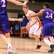 Ellinwood Eagle #35 Nathan Monday handles the ball at the top of the key. The Russell Broncos defeated the Ellinwood Eagles by a score of 60 to 17 in the Consolation Semi-Final of the 2018 Hoisington Winter Jam at the Hoisington Activity Center in Hoisington, Kansas on January 18, 2018. (Photo: Joey Bahr, www.joeybahr.com)