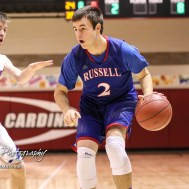 Russell Bronco #2 Tyler Whipple dribbles with the ball as Ellinwood Eagle #3 Lane Klepper defends. The Russell Broncos defeated the Ellinwood Eagles by a score of 60 to 17 in the Consolation Semi-Final of the 2018 Hoisington Winter Jam at the Hoisington Activity Center in Hoisington, Kansas on January 18, 2018. (Photo: Joey Bahr, www.joeybahr.com)