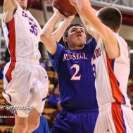 Russell Bronco #2 Tyler Whipple goes for a shot as Ellinwood Eagles #35 Nathan Monday and #3 Lane Klepper defends. The Russell Broncos defeated the Ellinwood Eagles by a score of 60 to 17 in the Consolation Semi-Final of the 2018 Hoisington Winter Jam at the Hoisington Activity Center in Hoisington, Kansas on January 18, 2018. (Photo: Joey Bahr, www.joeybahr.com)