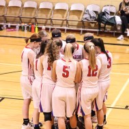 The Russell Lady Broncos huddle prior to the start of the game. The Russell Lady Broncos faced the Pratt Lady Greenbacks in the First Round of the 2018 Hoisington Winter Jam at the Hoisington High School in Hoisington, Kansas on January 16, 2018. (Photo: Joey Bahr, www.joeybahr.com)