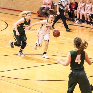 Russell Lady Bronco #3 Tiffany Dortland drives down the court with the ball. The Russell Lady Broncos faced the Pratt Lady Greenbacks in the First Round of the 2018 Hoisington Winter Jam at the Hoisington High School in Hoisington, Kansas on January 16, 2018. (Photo: Joey Bahr, www.joeybahr.com)