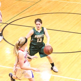 Pratt Lady Greenback #13 Madalynn Wilson as Russell Lady Bronco #25 Jaclyn Schulte defends. The Russell Lady Broncos faced the Pratt Lady Greenbacks in the First Round of the 2018 Hoisington Winter Jam at the Hoisington High School in Hoisington, Kansas on January 16, 2018. (Photo: Joey Bahr, www.joeybahr.com)