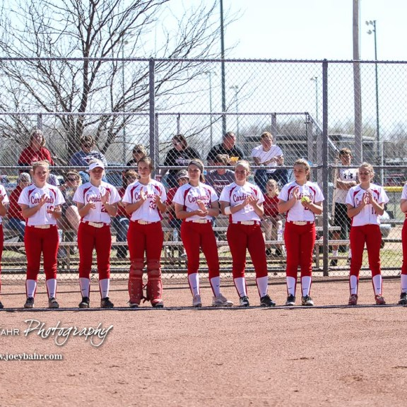 The Hoisington Lady Cardinals line up for player introductions prior to the game. The Hoisington Lady Cardinals defeated the Halstead Lady Dragons by a score of 12 to 2 in six innings at Logan Field in Hoisington, Kansas on April 27, 2018. (Photo: Joey Bahr, www.joeybahr.com)