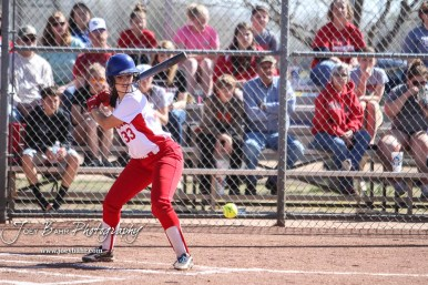 Hoisington Lady Cardinal Trinity Dolezal (#33) watches a pitch come in low in the bottom of the first inning. The Hoisington Lady Cardinals defeated the Halstead Lady Dragons by a score of 12 to 2 in six innings at Logan Field in Hoisington, Kansas on April 27, 2018. (Photo: Joey Bahr, www.joeybahr.com)