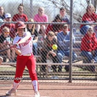Hoisington Lady Cardinal Jenna Urban (#27) swings at a pitch in the bottom of the first inning. The Hoisington Lady Cardinals defeated the Halstead Lady Dragons by a score of 12 to 2 in six innings at Logan Field in Hoisington, Kansas on April 27, 2018. (Photo: Joey Bahr, www.joeybahr.com)