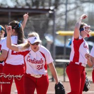 The Hoisington Lady Cardinal infield break from a huddle to start the top of the second inning. The Hoisington Lady Cardinals defeated the Halstead Lady Dragons by a score of 12 to 2 in six innings at Logan Field in Hoisington, Kansas on April 27, 2018. (Photo: Joey Bahr, www.joeybahr.com)