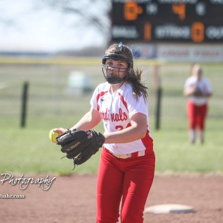 Hoisington Lady Cardinal Taylor Boxberger (#24) winds up to throw a pitch in the top of the fourth inning. The Hoisington Lady Cardinals defeated the Halstead Lady Dragons by a score of 12 to 2 in six innings at Logan Field in Hoisington, Kansas on April 27, 2018. (Photo: Joey Bahr, www.joeybahr.com)