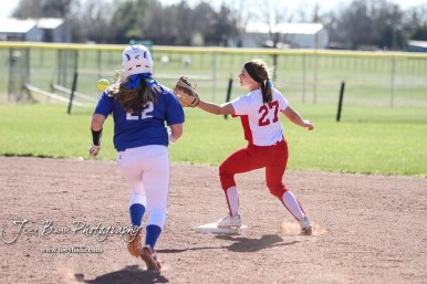 Hoisington Lady Cardinal Jenna Urban (#27) scrambles to catch a ball at second base as Halstead Lady Dragon Brittley Day (#22) runs towards the bag in the top of the fourth inning. The Hoisington Lady Cardinals defeated the Halstead Lady Dragons by a score of 12 to 2 in six innings at Logan Field in Hoisington, Kansas on April 27, 2018. (Photo: Joey Bahr, www.joeybahr.com)
