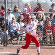 Hoisington Lady Cardinal Brooke Bachar (#18) swings at a ball in the bottom of the fourth inning. The Hoisington Lady Cardinals defeated the Halstead Lady Dragons by a score of 12 to 2 in six innings at Logan Field in Hoisington, Kansas on April 27, 2018. (Photo: Joey Bahr, www.joeybahr.com)