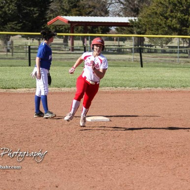 Hoisington Lady Cardinal Jenna Urban (#27) rounds second base on her way to third to lead off the bottom of the fifth inning. The Hoisington Lady Cardinals defeated the Halstead Lady Dragons by a score of 12 to 2 in six innings at Logan Field in Hoisington, Kansas on April 27, 2018. (Photo: Joey Bahr, www.joeybahr.com)