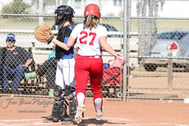 Hoisington Lady Cardinal Jenna Urban (#27) crosses home to score the fifth run of the game in the bottom of the fifth inning. The Hoisington Lady Cardinals defeated the Halstead Lady Dragons by a score of 12 to 2 in six innings at Logan Field in Hoisington, Kansas on April 27, 2018. (Photo: Joey Bahr, www.joeybahr.com)