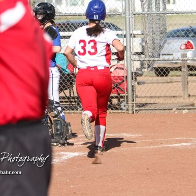 Hoisington Lady Cardinal Trinity Dolezal (#33) runs to home to plate the eighth run of the game in the bottom of the sixth inning. The Hoisington Lady Cardinals defeated the Halstead Lady Dragons by a score of 12 to 2 in six innings at Logan Field in Hoisington, Kansas on April 27, 2018. (Photo: Joey Bahr, www.joeybahr.com)