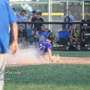 Spearville Royal Lancer #27 Nathan Heeke slides home in the bottom of the fourth inning to score a run. The Spearville Royal Lancers defeated the Bluestem Lions 5 to 1 in the KSHSAA Class 2-1A State Baseball Quarterfinal at the Great Bend Sports Complex in Great Bend, Kansas on May 24, 2018. (Photo: Joey Bahr, www.joeybahr.com)