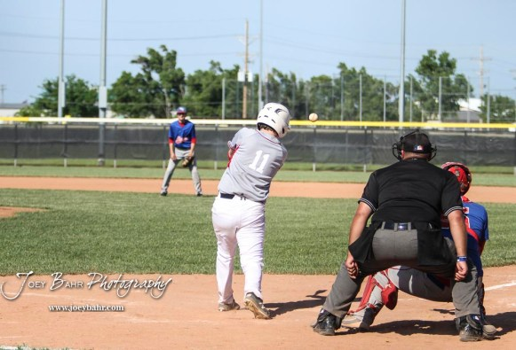 Chase County Bulldog #11 Arlen Sigel swings at a pitch in the top of the fourth inning. The Chase County Bulldogs defeated the West Elk Patriots 16 to 5 in the KSHSAA Class 2-1A State Baseball Quarterfinal at the Great Bend Sports Complex in Great Bend, Kansas on May 24, 2018. (Photo: Joey Bahr, www.joeybahr.com)