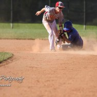Chase County Bulldog #13 Blaise Holloway catches West Elk Patriot #14 Cade Miller stealing in the bottom of the fourth inning. The Chase County Bulldogs defeated the West Elk Patriots 16 to 5 in the KSHSAA Class 2-1A State Baseball Quarterfinal at the Great Bend Sports Complex in Great Bend, Kansas on May 24, 2018. (Photo: Joey Bahr, www.joeybahr.com)