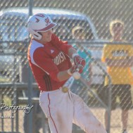 Hoisington Cardinal Myles Menges (#4) makes contact with a pitch in the bottom of the first inning. The Hoisington Cardinals defeated the Halstead Dragons by a score of 10 to 6 at Legion Field in Hoisington, Kansas on April 27, 2018. (Photo: Joey Bahr, www.joeybahr.com)
