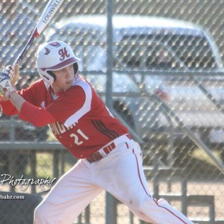 Hoisington Cardinal Isaac Prosser (#21) waits for a pitch to approach the plate in the bottom of the first inning. The Hoisington Cardinals defeated the Halstead Dragons by a score of 10 to 6 at Legion Field in Hoisington, Kansas on April 27, 2018. (Photo: Joey Bahr, www.joeybahr.com)