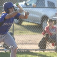 Halstead Dragon Noah Mendez (#24) bunts the ball in the top of the second inning. The Hoisington Cardinals defeated the Halstead Dragons by a score of 10 to 6 at Legion Field in Hoisington, Kansas on April 27, 2018. (Photo: Joey Bahr, www.joeybahr.com)